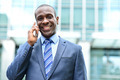 Smiling male professional talking on cell phone - PhotoDune Item for Sale