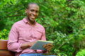 Happy guy using his tablet pc, outdoors - PhotoDune Item for Sale