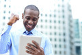 Businessman celebrates his success with tablet - PhotoDune Item for Sale