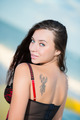 Portrait of smiling young brunette with tattoo - PhotoDune Item for Sale
