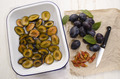cut plums in an enamel bowl - PhotoDune Item for Sale