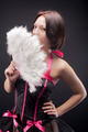 Young attractive woman with fan over black background - PhotoDune Item for Sale