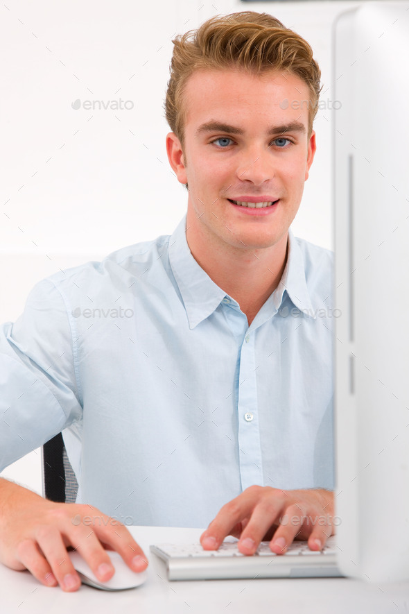 Smart young businessman using computer