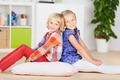 Girls Smiling Together On Hardwood Floor - PhotoDune Item for Sale