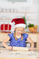 Girl Rolling Dough On Kitchen Counter - PhotoDune Item for Sale