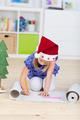 Girl with santa´s hat writing wishlist - PhotoDune Item for Sale