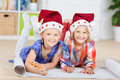 Happy Girls In Santa Hats Drawing On Chart Paper - PhotoDune Item for Sale