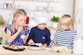 Three girls Baking Cupcakes At Kitchen Counter - PhotoDune Item for Sale