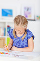 Girl Drawing With Color Pencil On Table - PhotoDune Item for Sale