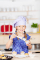 Kid Garnishing Cupcakes At Kitchen Counter - PhotoDune Item for Sale