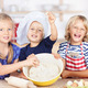 Sisters Putting Dough In Bowl At Kitchen Counter - PhotoDune Item for Sale
