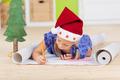 Cute girl writing letter to santa - PhotoDune Item for Sale