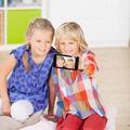 Sisters Taking Self Portrait Through Mobile Phone - PhotoDune Item for Sale