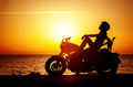 Woman biker enjoying sunset - PhotoDune Item for Sale
