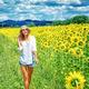 Walking on sunflowers field - PhotoDune Item for Sale