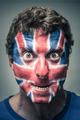 Spooky man with British flag painted on face - PhotoDune Item for Sale