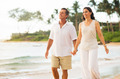 Mature Couple Enjoying Walk on the Beach - PhotoDune Item for Sale