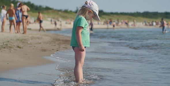 Girl Standing near the Sea