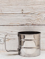 empty metal mug on old wooden table - PhotoDune Item for Sale
