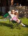 cute girl in sunglasses sunbathing at backyard