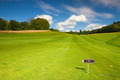 Empty golf fairway in sunny day - PhotoDune Item for Sale