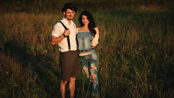 Loving couple posing At Aunset Country And Nature