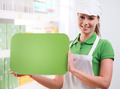 Female sales clerk with green sign - PhotoDune Item for Sale