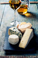 Various types of cheese and white wine - PhotoDune Item for Sale