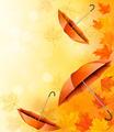 Autumn background with autumn leaves and orange umbrellas. - PhotoDune Item for Sale