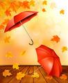 Autumn background with autumn leaves and orange umbrellas - PhotoDune Item for Sale