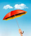 Hand holding a red and yellow umbrella - PhotoDune Item for Sale