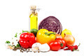 Fresh vegetables and olive oil on a white background. - PhotoDune Item for Sale