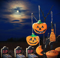 Halloween cookies hanging on a tree in the night sky - PhotoDune Item for Sale