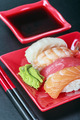 seafood sushi and chopstick on a red plate - PhotoDune Item for Sale