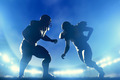 American football players in game, quarterback running. Stadium lights - PhotoDune Item for Sale