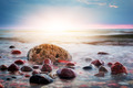 Dramatic colorful sunset on a rocky beach. Baltic sea - PhotoDune Item for Sale