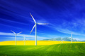 Wind turbines on spring field. Alternative, clean and natural energy - PhotoDune Item for Sale