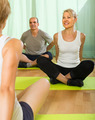 Mature couple practicing yoga with instructor - PhotoDune Item for Sale