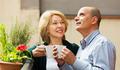 Couple drinking tea at balcony - PhotoDune Item for Sale