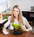 Woman weighing chocolate on kitchen scales - PhotoDune Item for Sale