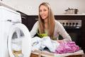 woman with linen basket near washing machine - PhotoDune Item for Sale
