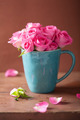 beautiful pink roses bouquet in mug