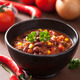 mexican chili con carne in black bowl with ingredients - PhotoDune Item for Sale