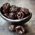 Prunes in Black Bowl - PhotoDune Item for Sale