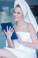 Woman in Bath Towel Holding Tablet Computer - PhotoDune Item for Sale
