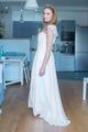 Woman Wearing Wedding Dress Standing in Kitchen - PhotoDune Item for Sale