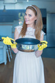 Smiling Woman Wearing Wedding Gown and Holding Pan - PhotoDune Item for Sale
