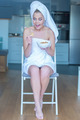 Surprised Woman in Bath Towel with Bowl of Snacks - PhotoDune Item for Sale