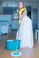 Woman Wearing Gown Mopping Floor in Kitchen - PhotoDune Item for Sale
