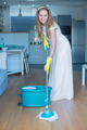 Woman Wearing Wedding Gown Mopping Floor - PhotoDune Item for Sale